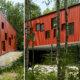 Eksteriørfoto Åskollen skole. Gavlvegg med rødt stående panel ulike vindusformater. Rød yttervegg hviler på glassboks.