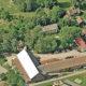 Flyfoto av byggene og tunet på Tveten gård